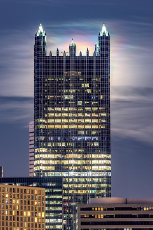 A rainbow emerges from behind PPG Place as the moon lights up the night