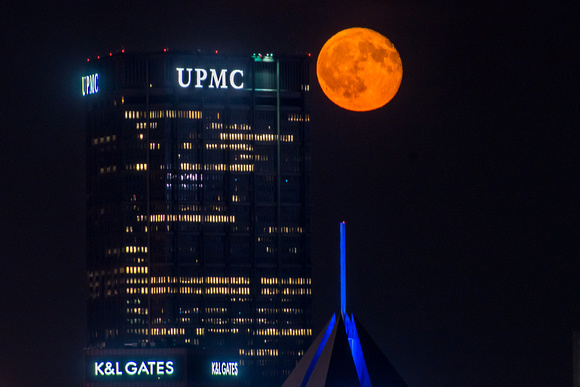 The moon glows beside the Steel Building in Pittsburgh