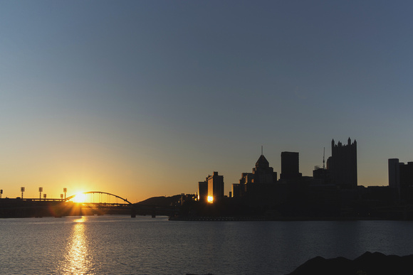 Sunrise reflects in downtown Pittsburgh