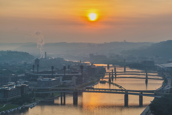 The sun lights up the Allegheny River at dawn in Pittsburgh