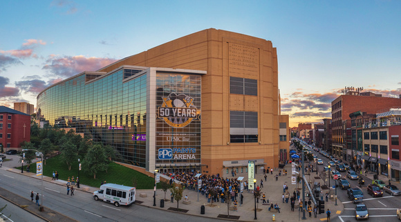 Fans rush into PPG Paints Arena during the Pittsburgh Penguins home opener