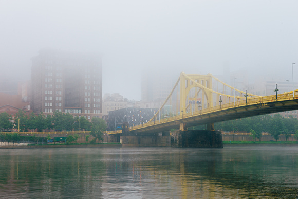 The Renaissance and Roberto Clemente Bridge seen through the fog in Pittsburgh