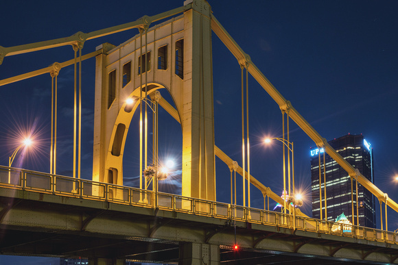 The Supermoon sits under the Andy Warhol Bridge