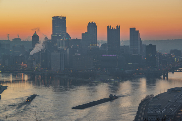 Barges cross at the Point in Pittsburgh at dawn