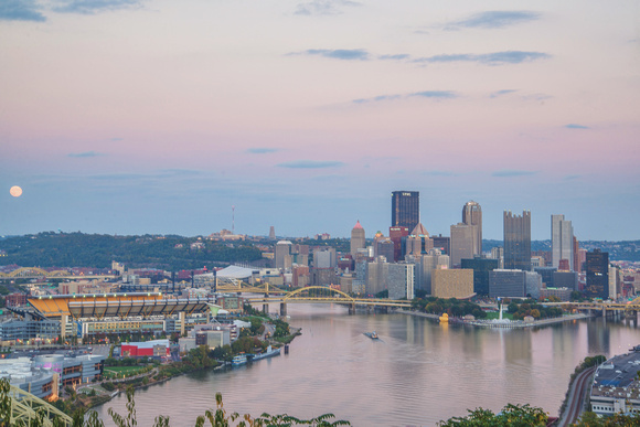 A colorful sky during sunset over Pittsburgh from the West End Overlook and the Giant Rubber Duck