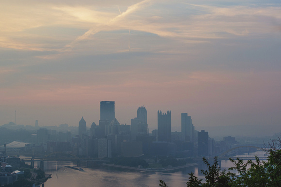 Colorful hazy Pittsburgh skyline from the West End Overlook