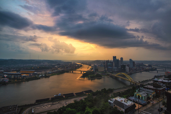 The sun breaks through the clouds over Pittsburgh after a storm