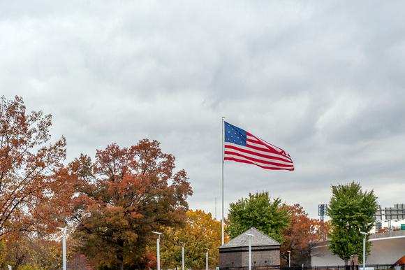 The American flag rises over the fall colors in Pittsburgh