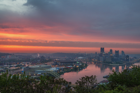 The sky is on fire above Pittsburgh at dawn as seen from the West End Overlook