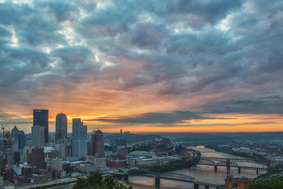 Light coming through the clouds at dawn over Pittsburgh