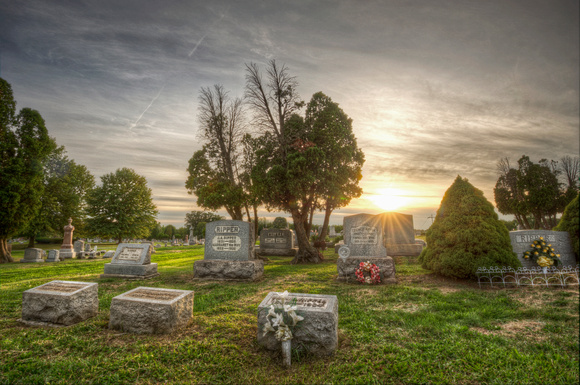 Sunset over graves at Evans City Cemetery HDR