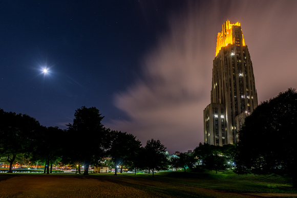 The moon and Victory Lights on the Cathedral of Learning glow bright after Pitt defeated Penn State