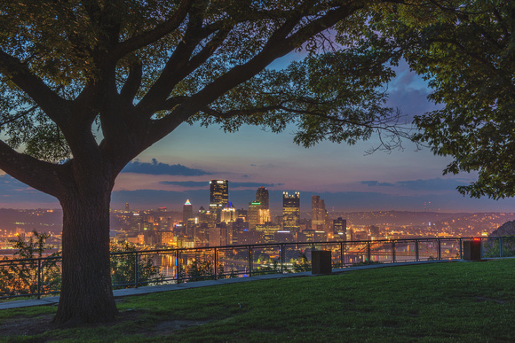 Pittsburgh skyline through the trees on the West End Overlook