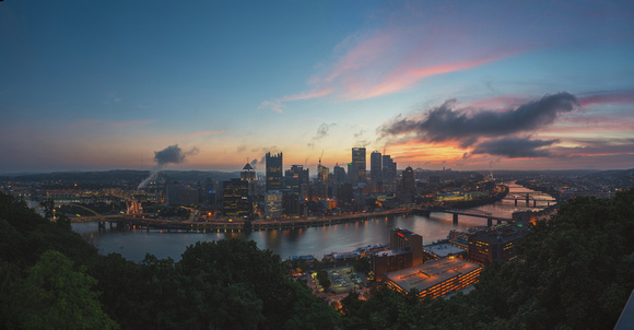 Panorama of a colorful sunrise over the Pittsburgh skyline