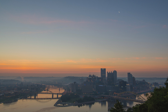 Soft colors above the Pittsburgh skyline at dawn