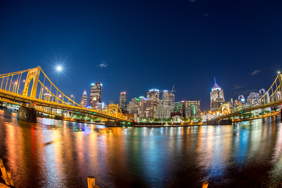A fisheye view from the North Shore of the supermoon over Pittsburgh