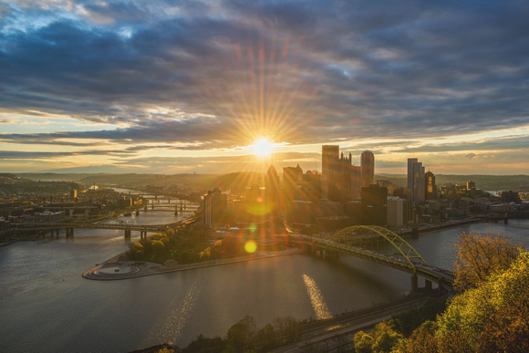 Sunflare through the Pittsburgh skyline at dawn from Mt. Washington