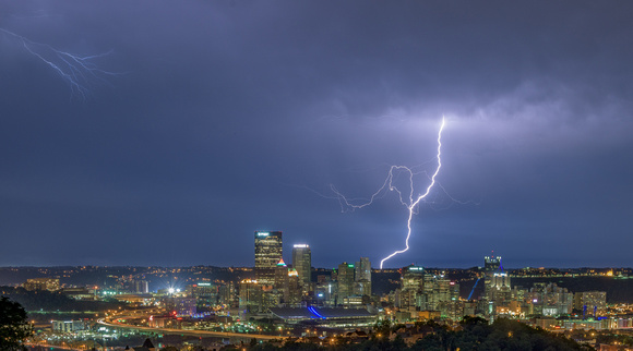 A jagged lightning bolt strikes behind Pittsburgh