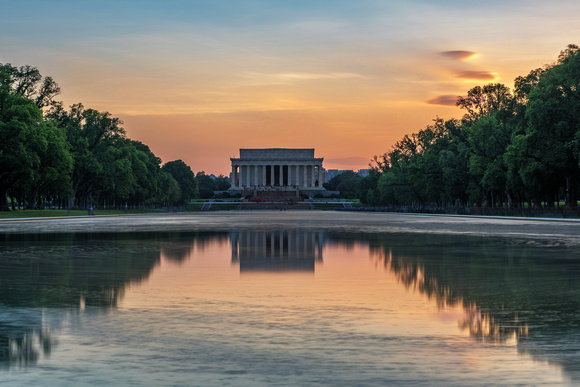 A long exposure of a deep orange sunset over the Lincoln Memorial in Washington DC