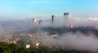 Pittsburgh is engulfed in fog in this view from the South Side Slopes