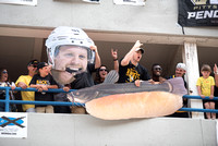 A giant Phil Kessel head and catfish on a hot dog during the Pittsburgh Penguins Victory Parade