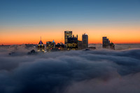 Waves of fog blanket the Pittsburgh skyline