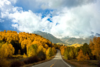 An open road and beautiful sunlight on the way to Telluride in Colorado