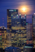 PPG Place and the Steel Building sit under a full moon in Pittsburgh