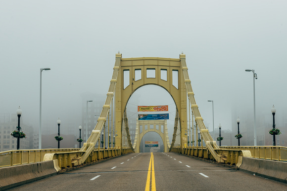 Pittsburgh disappears into the fog behind the Roberto Clemente Bridge