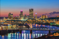 A view of Pittsburgh up the Monongahela River at dusk