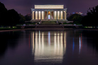 The Lincoln Memorial reflects int he Reflecting Pool in the middle of the night in Washington DC