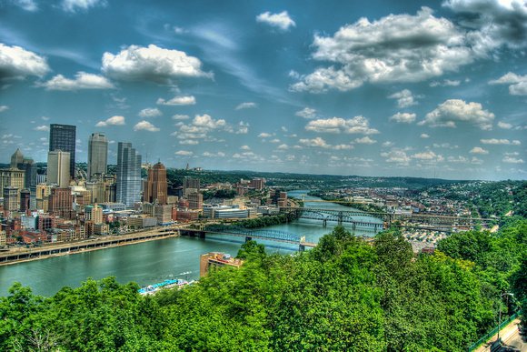 Pittsburgh skyline up the Monongahela with clouds HDR