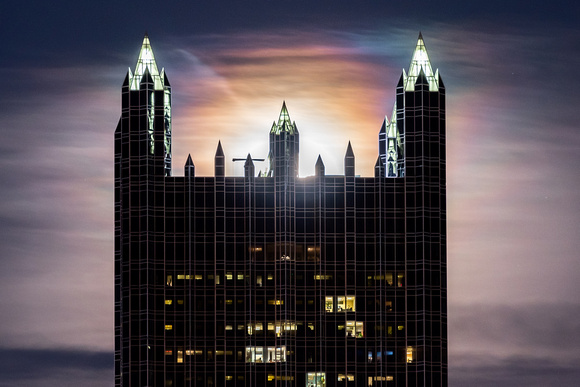 A full moon shines behind PPG Place in Pittsburgh