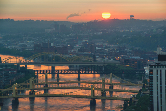 Red rivers and bridges at dawn in Pittsburgh