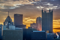 Light rays shining through Pittsburgh at dawn