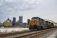 Train along the Ohio River with Pittsburgh in the background