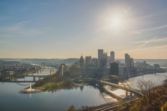 Sun shining over the Pittsburgh skyline at dawn