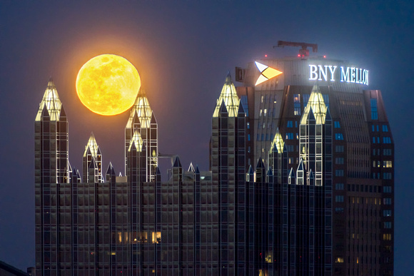 A full moon glows above the spires of PPG Place in Pittsburgh