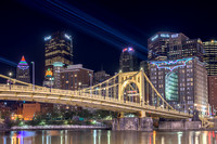 Lasers illuminate Bat Signals on downtown Pittsburgh