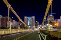 On the Clemente Bridge in Pittsburgh as the Bat Signals shine bright