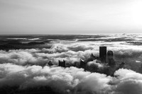 Black and white view of Pittsburgh on a foggy morning from the air