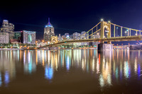 Colorful reflections of Pittsburgh and the Bat Signals