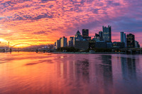 A cotton candy sky provides a stunning background for Pittsburgh at dawn