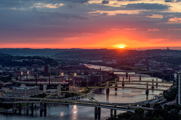 The sun glows as it crosses the horizon in Pittsburgh