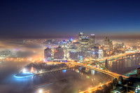 Fog surrounds the Pittsburgh skyline at dawn