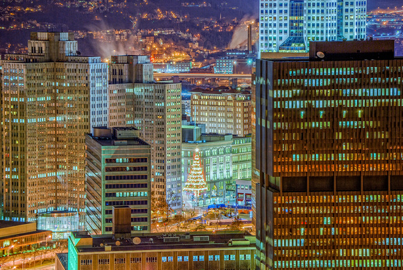 A Christmas tree is seen in downtown Pittsburgh at night from Mt. Washington HDR