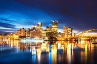 Downtown Pittsburgh glows from the banks of the horizon just before dawn