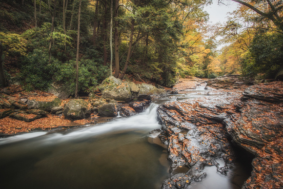 Long exposure of the bottom of the natural rock slides at Ohiopyle State Park in autumn