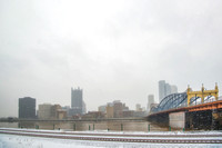 A snowy Pittsburgh skyline in winter from Station Square