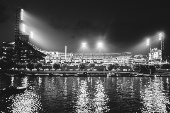 A black and white view of PNC Park from the river